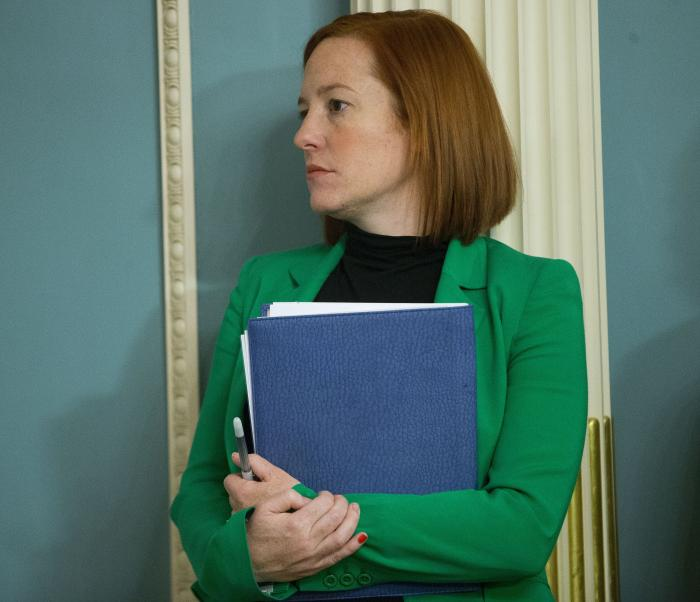 State Department spokeswoman Jen Psaki stands in on a meeting in Washington.