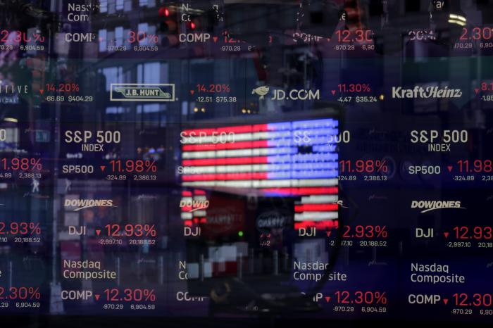 A United States flag is reflected in the window of the Nasdaq studio.